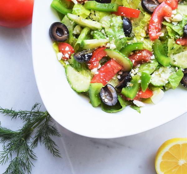 Greek Salad Pitas with Avocado Tzatziki - a homemade Greek dressing and avocado tzatziki send these pitas over the top! | tastythin.com