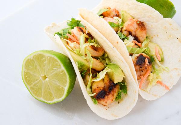 Honey Lime Shrimp Tacos - honey, lime, and garlic marinated shrimp topped with slaw and avocado. | tastythin.com