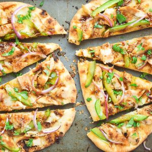 Asian Barbecue Chicken Flatbread Pizza - a simple homemade Asian barbecue sauce is the perfect addition to this pizza. Make this for your next party!   tastythin.com