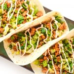 Chipotle Lime Chicken Tacos - just a few ingredients needed for these chicken tacos with chipotle lime sauce. Fresh, simple, and delicious! | tastythin.com