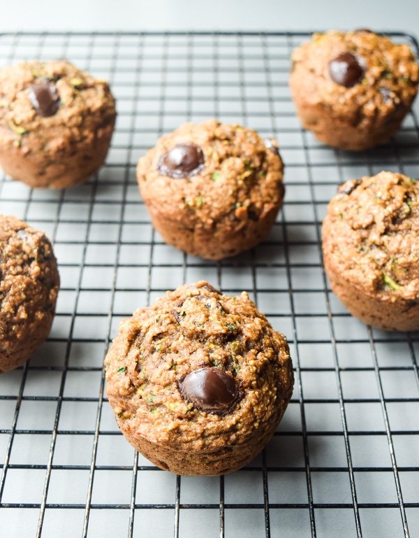 Zucchini Applesauce Muffins - these hearty muffins are light on calories and full of nutritious veggies and fruit. An excellent grab-and-go breakfast or snack | tastythin.com