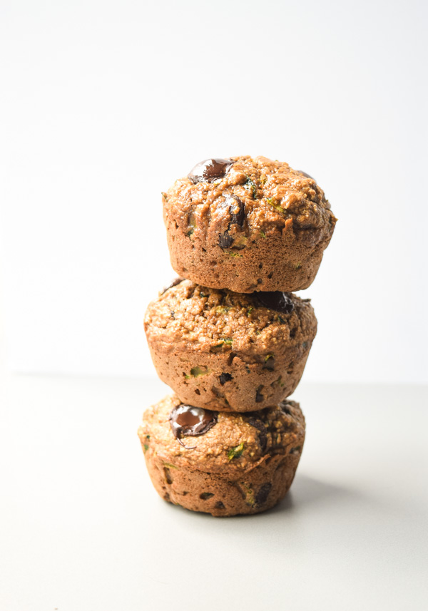 Zucchini Applesauce Muffins - these hearty muffins are light on calories and full of nutritious veggies and fruit. An excellent grab-and-go breakfast or snack   tastythin.com