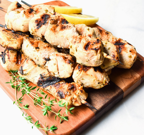 Greek Lemon Chicken Skewers - this all purpose marinade is fresh, light, and full of huge flavor! A summertime grilling favorite. | tastythin.com