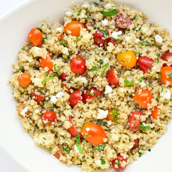 Tomato Herb Quinoa Salad - A trio of sweet cherry tomatoes, fresh herbs, and creamy goat cheese brighten this tasty salad! | tastythin.com