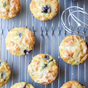 Fat Free Blueberry Lemon Muffins - Sweet berries, tart lemon, and a yummy glaze combine for an indulgent tasting muffin, but without the guilt! | tastythin.com