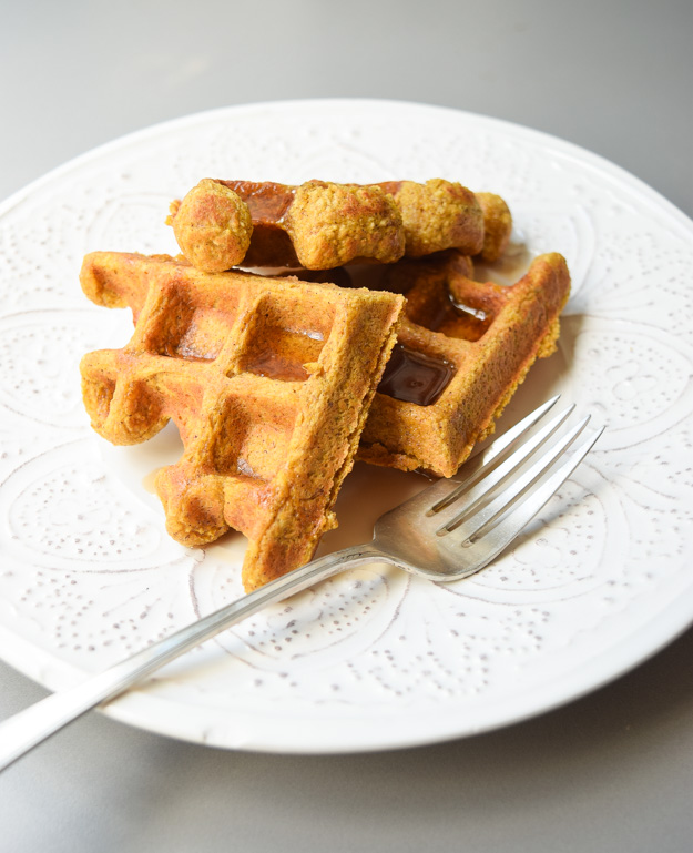 Pumpkin Oat Waffles - these gluten free, tasty waffles can be made ahead and frozen for a quick breakfast the whole family will love!   tastythin.com