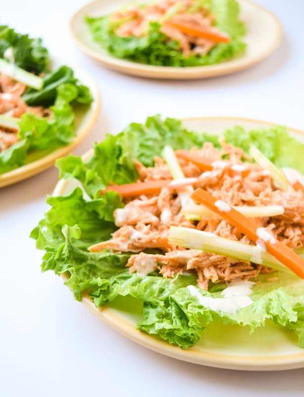 Slow Cooker Buffalo Chicken Lettuce Wraps - Just like the classic comfort food without the calories! (recipe credit Skinnytaste.com) | tastythin.com