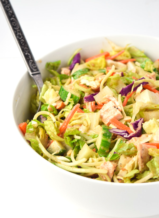 Thai Chicken Chopped Salad (Whole30 Paleo) - Crunchy veggies, chicken, and a sweet and tangylime dressing combine for a tasty and satisfying meal. Whole30 approved!   tastythin.com
