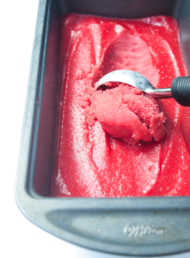 Easy Strawberry Sorbet (Paleo) - simple 2 ingredient recipe, so light and refreshing and bursting with fresh strawberry flavor! | tastythin.com