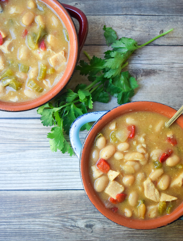 White Chicken Chili - a classic favorite with chicken, white beans, and plenty of veggies and spice.  Creamy, comforting, and nutritious! | tastythin.com