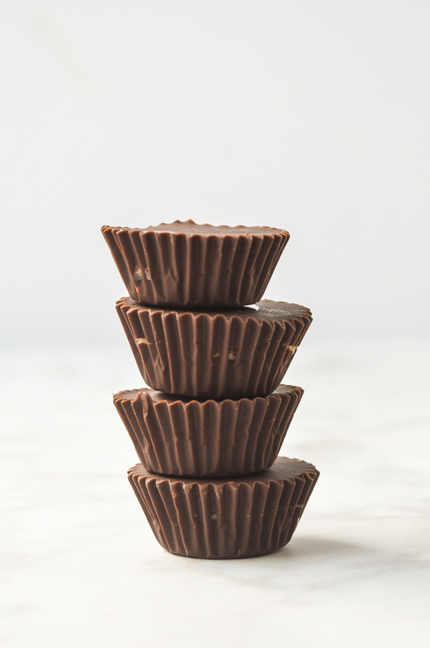mini chocolate almond butter cups stacked
