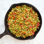 top down of rainbow veggie rice in skillet