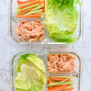 meal prep buffalo chicken lettuce wraps in 3 section glass containers