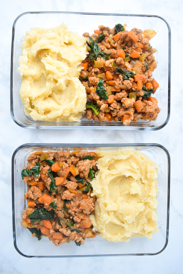 top down shot meal prep shepherd's pie in two glass containers