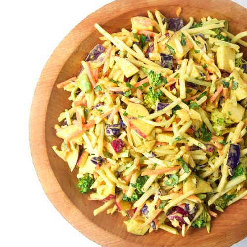 whole30 curried broccoli slaw in wooden bowl