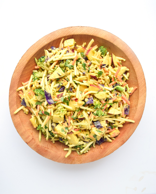 top down view of whole30 curried broccoli slaw in wooden bowl