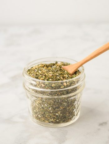 greek seasoning blend in mason jar with bamboo spoon