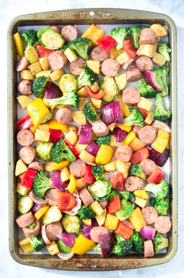 sausage and veggies on a large baking sheet