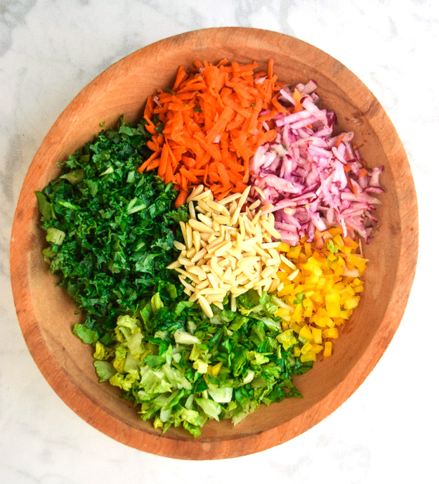 chopped detox salad ingredients in a large bowl