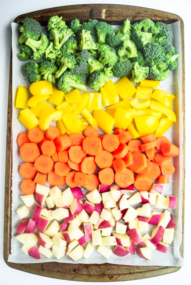 broccoil, yellow peppers, carrots, red potatoes on sheet pan