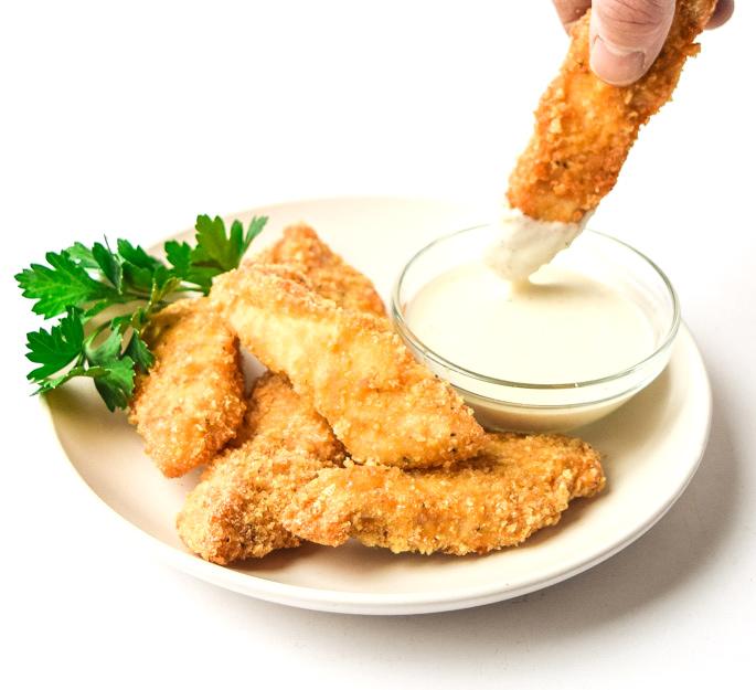 air fryer keto chicken tenders dipped in ranch dressing